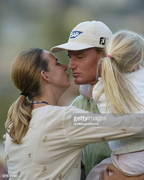 Ernie Els receives a victory kiss from his wife Liezl and a hug from his daughter Samantha at Waialae Country Club Sunday January 18 2004 at the Sony...