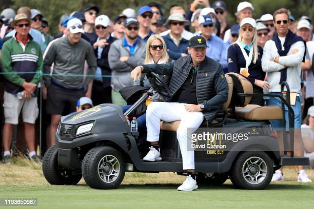 Ernie Els the International Team captain watches the golf with his wife Liezl during the second day foursomes matches in teh 2019 Presidents Cup at...