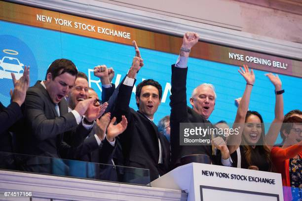 Ernie Garcia founder and chief executive officer of Carvana Co center rings the opening bell during the company's initial public offering on the...
