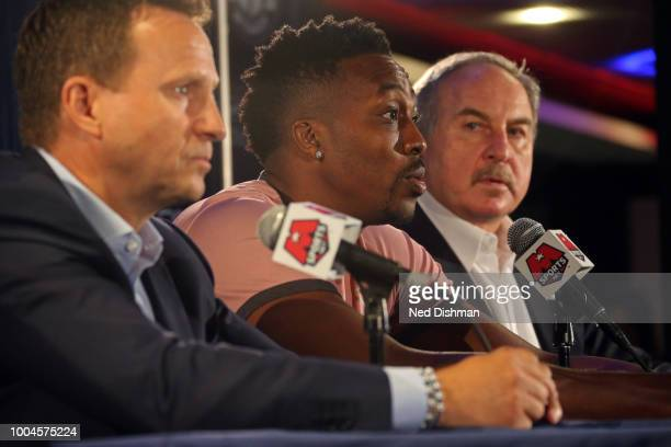 Ernie Grunfeld and Scott Brooks help introduce Dwight Howard of the Washington Wizards to the media during a press conference at the Capital One...