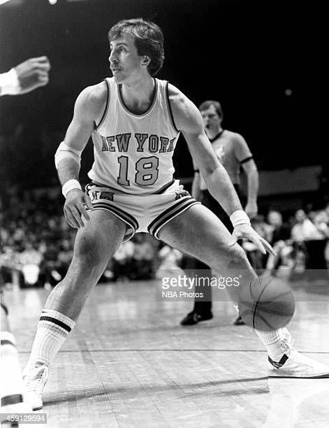 Ernie Grunfeld of the New York Knicks dribbles during game played circa 1984 at Madison Square Garden in New York City NOTE TO USER User expressly...