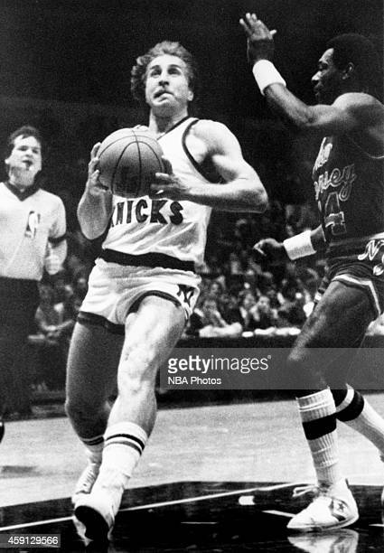 Ernie Grunfeld of the New York Knicks drives during game played against the New Jersey Nets circa 1984 at Madison Square Garden in New York City NOTE...