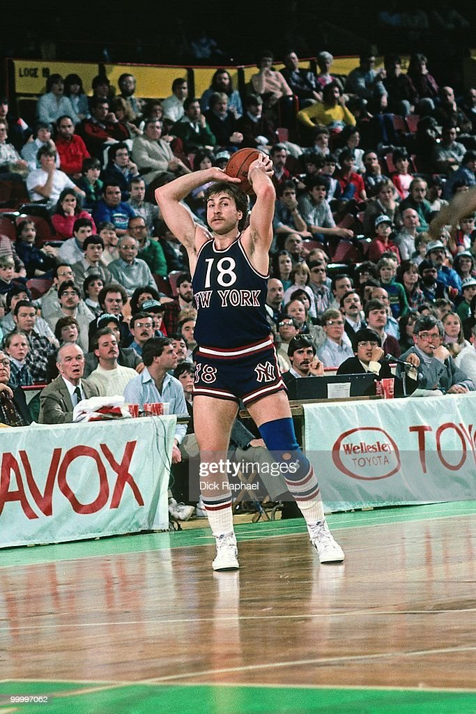 Ernie Grunfeld #18 of the New York Knicks passes against the Boston Celtics during a game played in 1983 at the Boston Garden in Boston, Massachusetts.