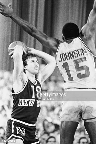 Ernie Grunfeld of the New York Knicks passes the ball during a game played against the Detroit Pistons circa 1984 at Madison Square Garden in New...