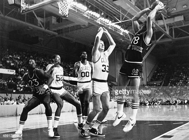 Ernie Grunfeld of the New York Knicks shoots during game played against the Boston Celtics circa 1984 at Madison Square Garden in New York City NOTE...
