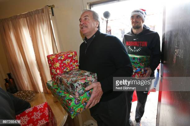 Ernie Grunfeld of the Washington Wizards helps hands out presents during the Washington Wizards Holiday Event on December 20 2017 in Washington DC...