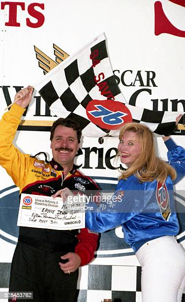 Ernie Irvan celebrates his NASCAR Sprint Cup Series win in Victory Lane following the Save Mart 300 He drove the No 28 TexacoHavoline Ford for Robert...