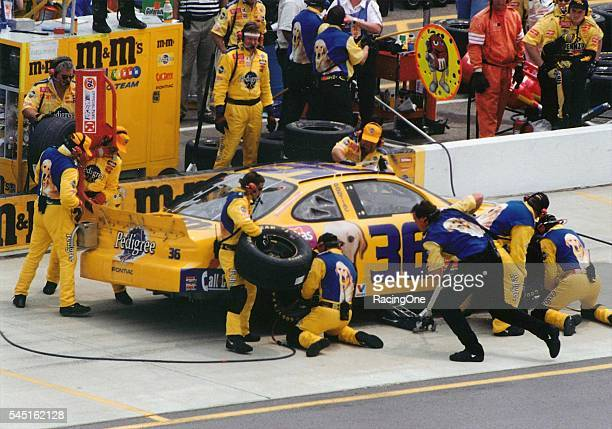 Ernie Irvan driver of the Pedigree Pontiac pits during the Kmart 400 at Michigan International Speedway on June 13 1999 in Brooklyn Michigan