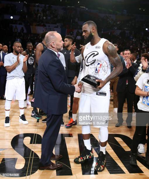 Ernie Johnson Jr presents the MVP trophy to LeBron James of Team LeBron for the NBA AllStar Game as a part of 2018 NBA AllStar Weekend at STAPLES...