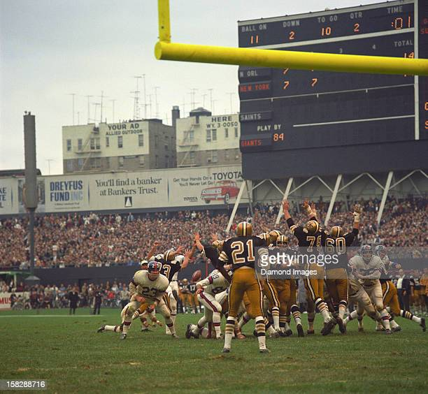 Ernie Koy of the New York Giants blocks on a kick during a game on October 8 1967 against the New Orleans Saints at Yankee Stadium in New York New...