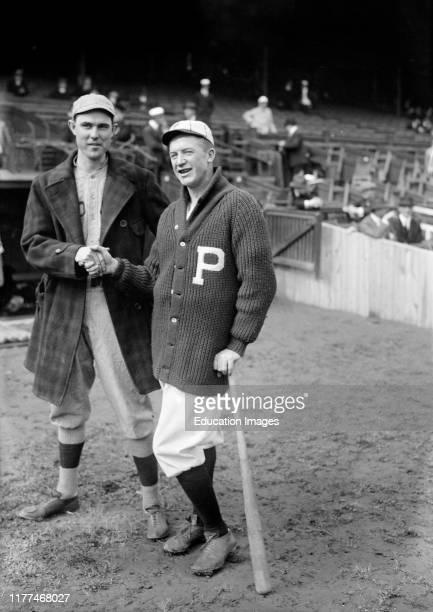 Ernie Shore left Boston Red Sox and Grover Cleveland Alexander Philadelphia Phillies Shaking Hands during World Series Philadelphia Pennsylvania USA...