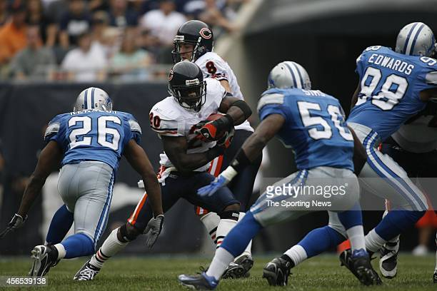Ernie Sims and Kenoy Kennedy of the Detroit Lions makes a gang tackle during a game against the Chicago Bears on September 17 2006 at Soldier Field...