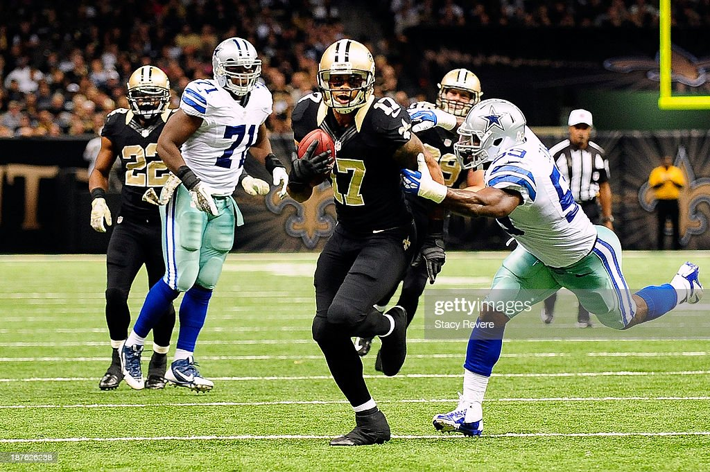 Ernie Sims #59 of the Dallas Cowboys tries to tackle Robert Meachem #17 of the New Orleans Saints during a game at the Mercedes-Benz Superdome on November 10, 2013 in New Orleans, Louisiana. New Orleans won the game 49-17.