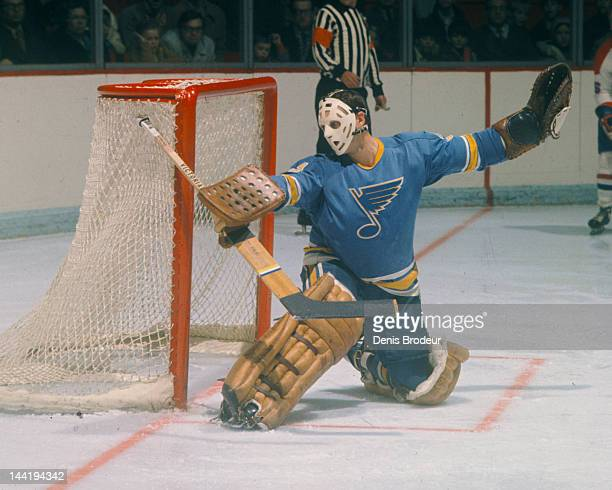 Ernie Wakely of the St Louis Blues makes a save during a game against the Montreal Canadiens Circa 1970 at the Montreal Forum in Montreal Quebec...