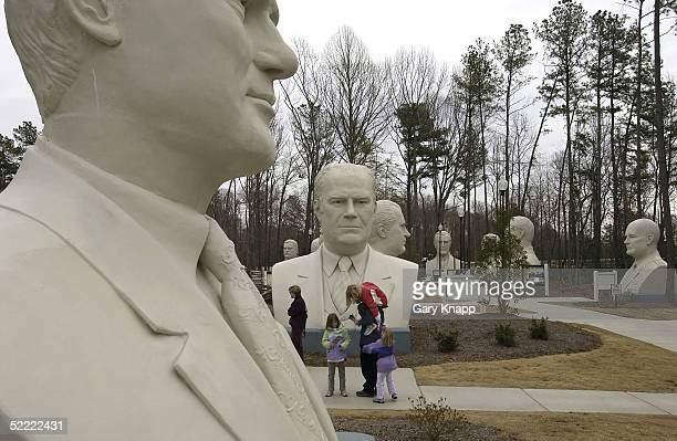 Ernie Wittich and his family walk among the 42 statues of the Presidents of the United States at the Presidents Parks February 20, 2005 in...