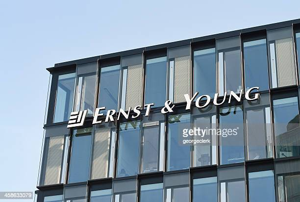 ernst and young office exterior - ernst & young stock photos and pictures