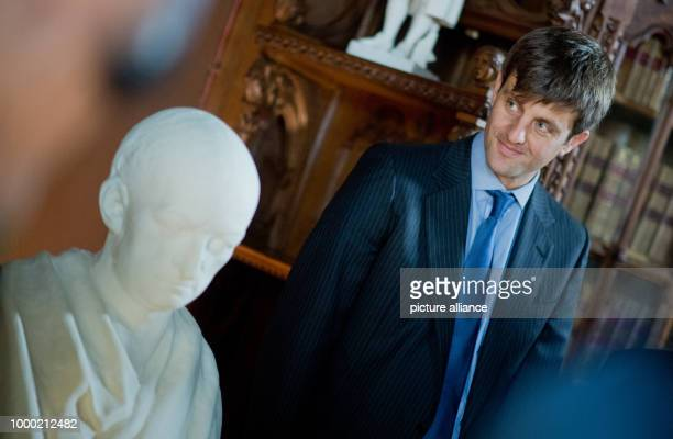 Ernst August of Hanover uncovers a bust of Gottfried Wilhelm Leibniz at the library at the palace Marienburg near Pattensen, Germany, 12 September...