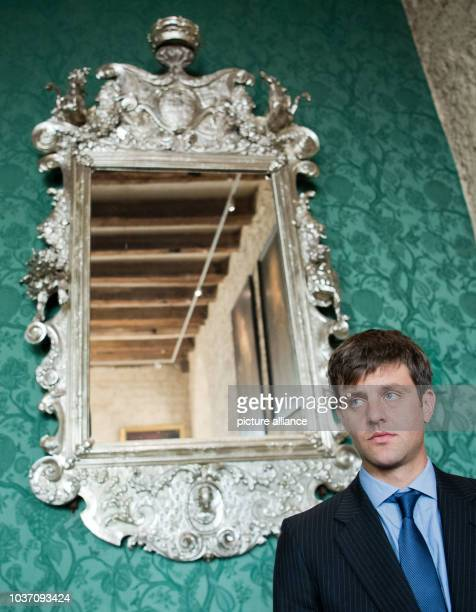 Ernst August von Hannover standing in front of a mirror during the unveiling of a bust of Gottfried Wilhelm Leibniz in the library at Marienburg...