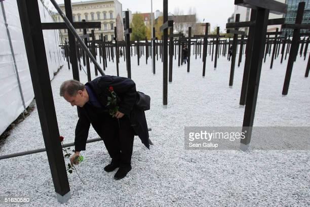 Ernst Piesche lays a rose at the cross commemorating his former friend Armin Brueckner during opening ceremonies of a new memorial of a rebuilt...