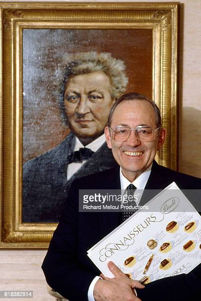 Ernst Tanner director of Lindt and Sprungli chocolate company in front of a portrait of Rodolphe SprungliAmmann who founded the company with his...