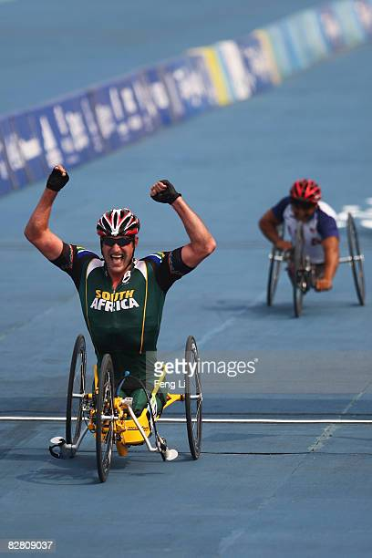 Ernst Van Dyk of South Africa celebrates after winning the Gold in the Road Cycling Men's Road Race at the Triathlon Venue during day eight of the...