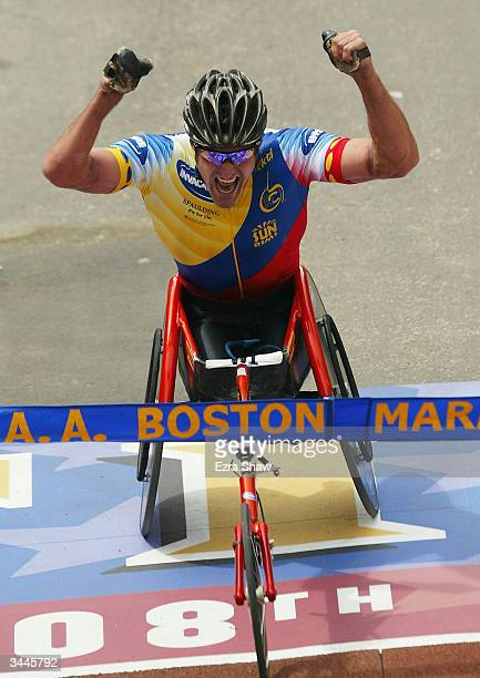 Ernst Van Dyk of the Republic of South Africa raises his arms just before he crosses the finish line to win the mens wheelchair division of the108th...