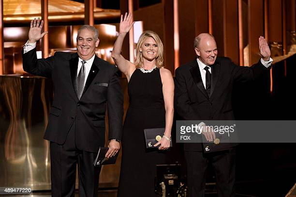 Ernst Young representatives are seen onstage during the 67th Annual Primetime Emmy Awards at Microsoft Theater on September 20 2015 in Los Angeles...