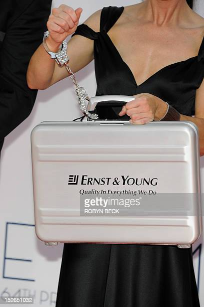 Ernst Young representatives arrive for the 64th annual Prime Time Emmy Awards at the Nokia Theatre at LA Live in Los Angeles California on September...