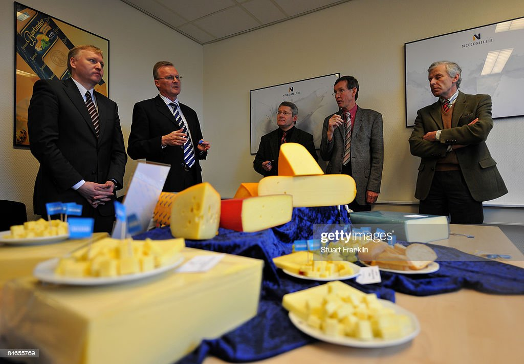 Ernst-Wilhelm Rabius, Argraculture Secratary (right) listerns to a talk about the cheese production by Doctor Josef Schwaiger, Manager of Nordmilch (second left) during a visit to the cheese dairy Nordmilch on February 5, 2009 in Nordheckstedt, near Flensburg, Germany.