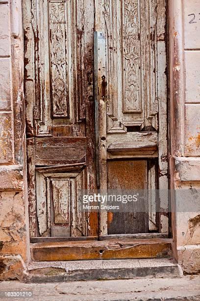 Eroded and broken antique door