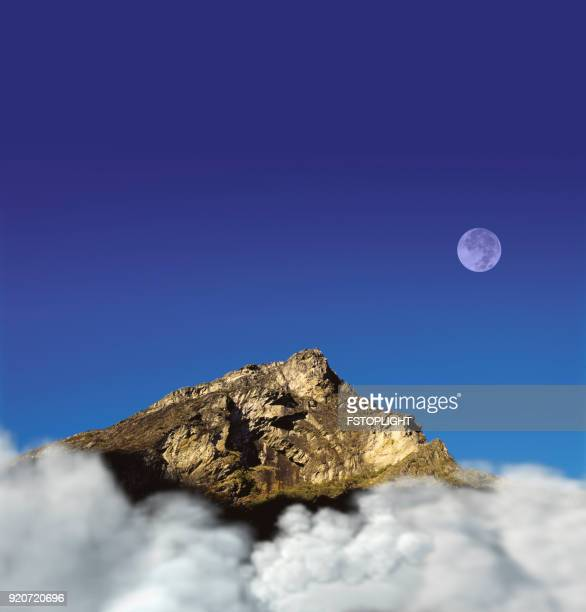 eroded mountain  with full moon - fstoplight stock photos and pictures