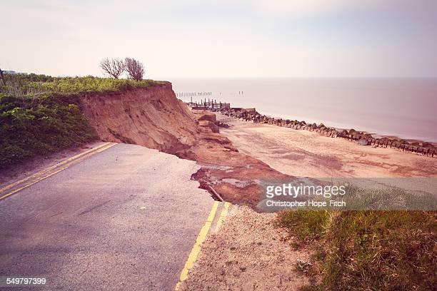 eroded road - erosionado fotografías e imágenes de stock