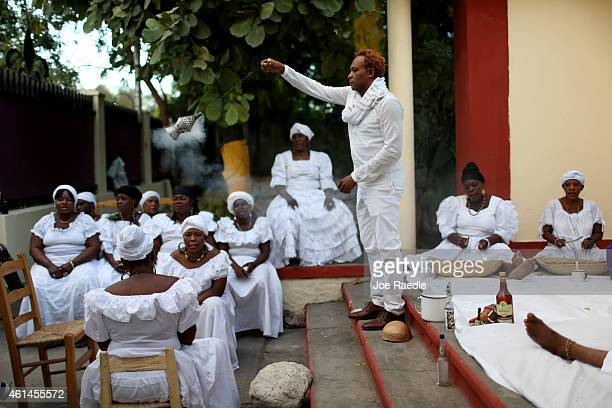 Erol Josue a Vodou priest performs a ceremony to bless those killed during a magnitude 70 earthquake that hit just before 5 pm on Jan 12 destroying...