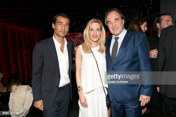 Erol Sander and his wife Caroline Goddet nice of Oliver Stone during the Europe premiere of the film 'Snowden' at Mathaeser Filmpalast on September...