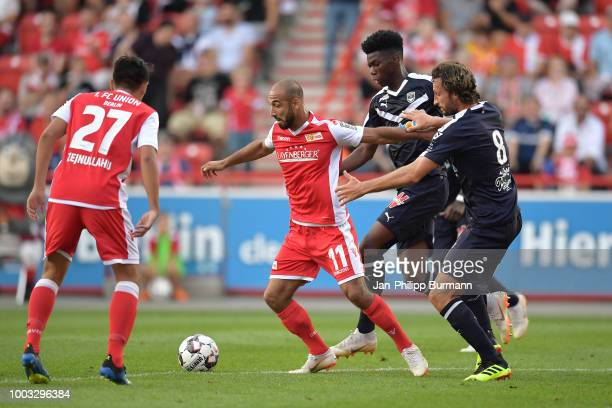 Eroll Zejnullahu Akaki Gogia of 1 FC Union Berlin Aurelien Tchouameni and Paul Baysse of FC Girondins Bordeaux during the test match between Union...
