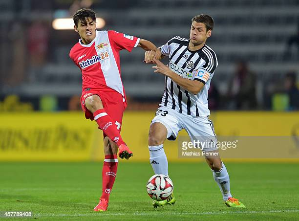 Eroll Zejnullahu of 1 FC Union Berlin and Andreas Hofmann of VfR Aalen during the game VfR Aalen against Union Berlin on October 24 2014 in Aalen...