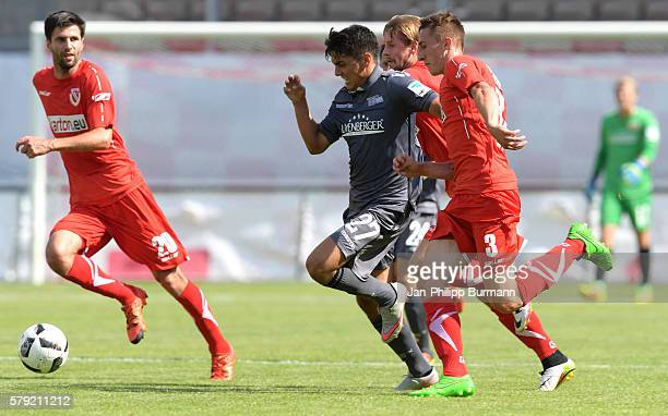 Eroll Zejnullahu of 1 FC Union Berlin and Erich Jeschke of FC Energie Cottbus during the test match between FC Energie Cottbus and 1 FC Union Berlin...