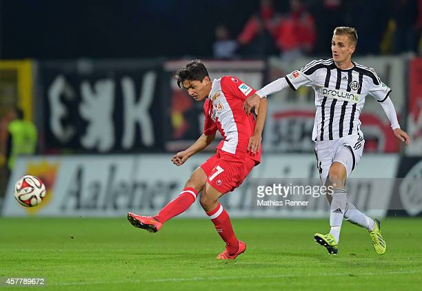 Eroll Zejnullahu of 1 FC Union Berlin and Oliver Barth of VfR Aalen during the game between 1 FC Union Berlin against VfR Aalen on october 24 2014 in...