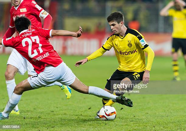 Eroll Zejnullahu of 1 FC Union Berlin challenges Christian Pulisic of Borussia Dortmund during the friendly match between 1 FC Union Berlin v...