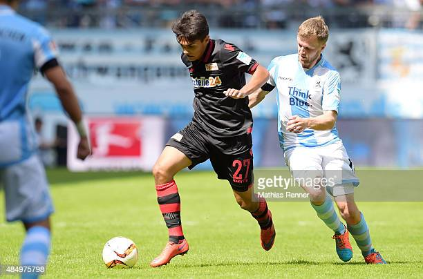 Eroll Zejnullahu of 1 FC Union Berlin handles the ball against Stephan Hain of TSV 1860 Muenchen during the game between TSV 1860 Muenchen and Union...
