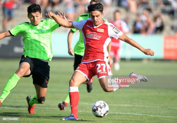 Eroll Zejnullahu of 1 FC Union Berlin shoots next to Burim Halili of Union Fuerstenwalde during the test match between dem FSV Union Fuerstenwalde...