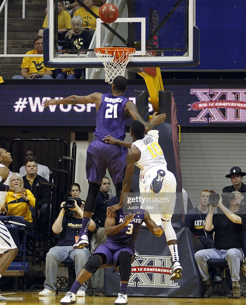 Eron Harris #10 of the West Virginia Mountaineers attempts a layup against Jordan Henriquez #21 and Martavious Irving #3 of the Kansas State Wildcats during the game at at the WVU Coliseum on January 12, 2013 in Morgantown, West Virginia.