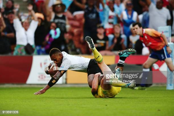 Eroni Sau of Fiji scores a try against James Stannard of Australia during the 2018 New Zealand Sevens at FMG Stadium on February 3 2018 in Hamilton...
