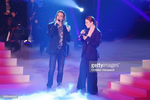 Eros Atomus Isler and Jess Glynne perform on stage during the finals of 'The Voice of Germany' on December 16 2018 in Berlin Germany
