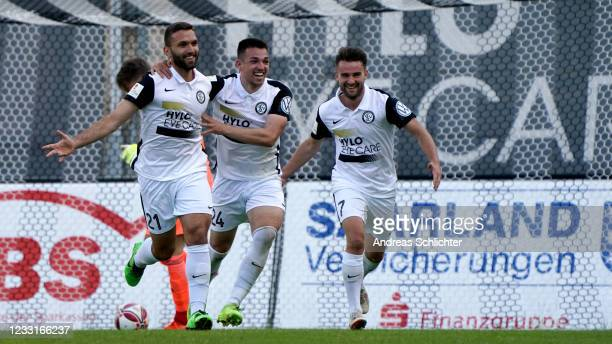 Eros Dacaj, Luca Schnellbacher and Manuel Feil of SV Elversberg celebrate during the Saarland Cup Final match between 1. FC Saarbrücken and SV...