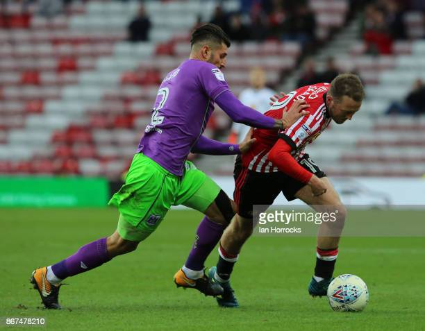 Eros Pisano of Bristol tries to halt Aiden McGeady of Sunderland during the Sky Bet Championship match between Sunderland and Bristol City at Stadium...