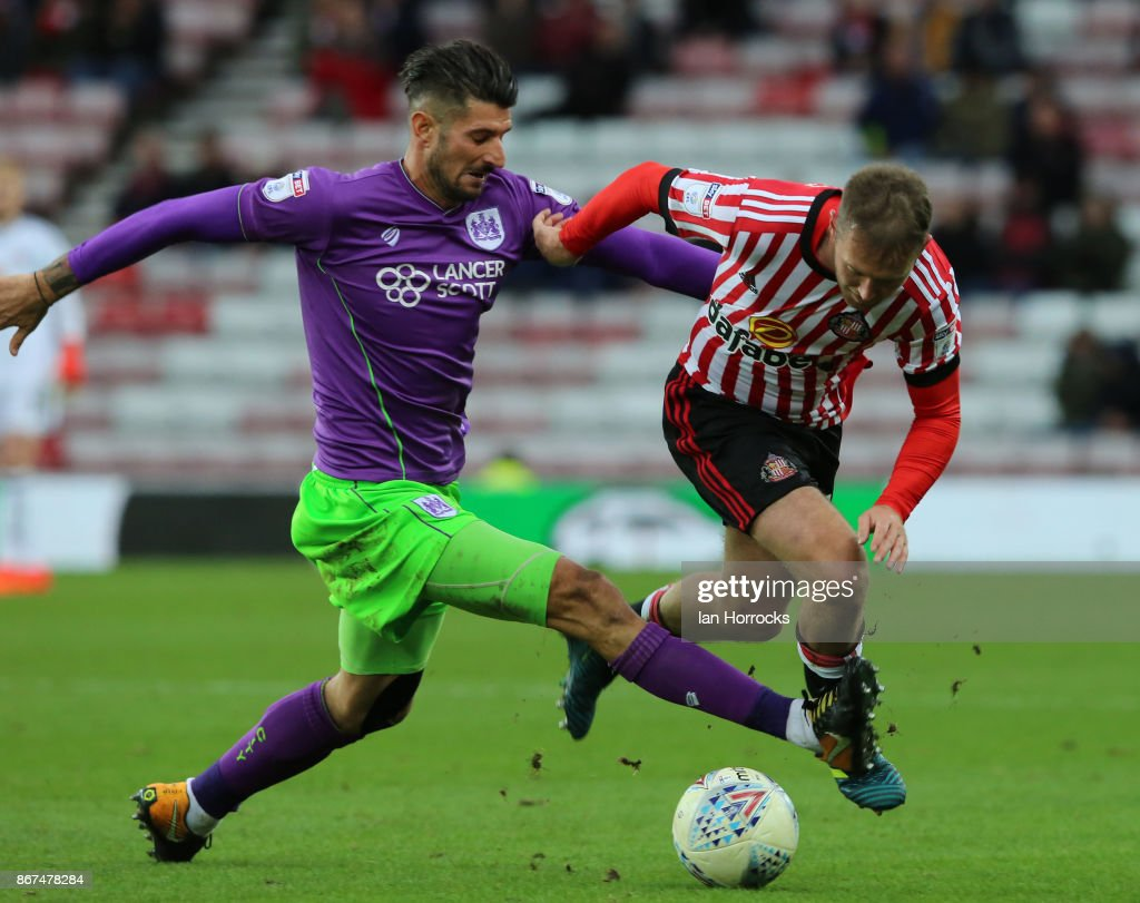 Eros Pisano of Bristol (L) tries to halt Aiden McGeady of Sunderland during the Sky Bet Championship match between Sunderland and Bristol City at Stadium of Light on October 28, 2017 in Sunderland, England.