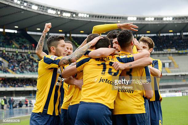 Eros Pisano of Hellas Verona celebrates with his team mates after scoring his teams second goal during the Serie A match between Hellas Verona FC and...