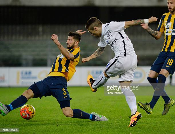 Eros Pisano of Hellas Verona competes with Alejandro Dario Gomez of Atalanta BC during the Serie A match between Hellas Verona FC and Atalanta BC at...