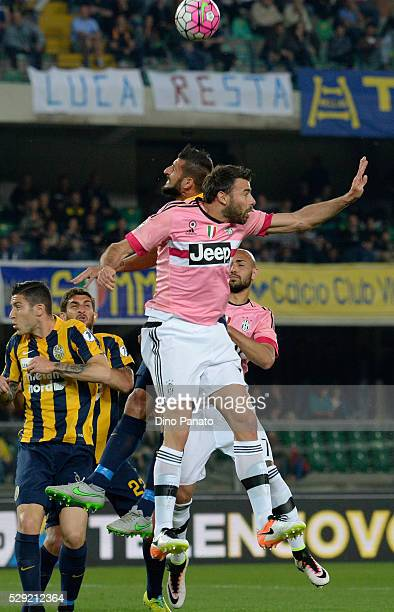 Eros Pisano of Hellas Verona competes with Andrea Barzagli of Juventus FC during the Serie A match between Hellas Verona FC and Juventus FC at Stadio...